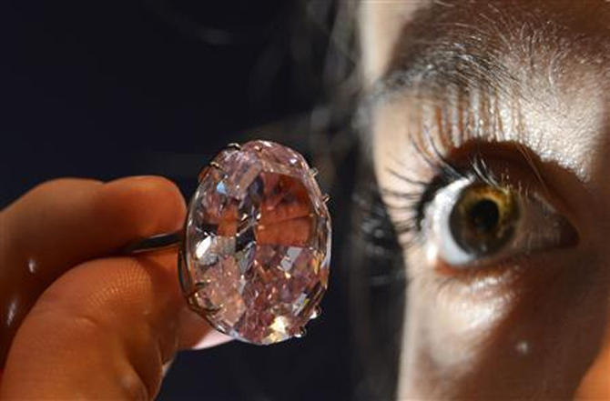 Model Annabeth Murphy-Thomas poses with The Pink Star diamond at Sotheby's auction.