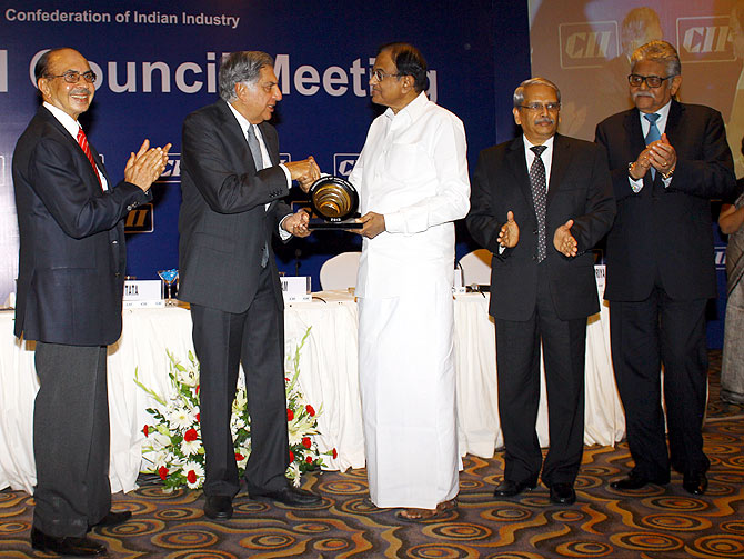 Finance Minister P Chidambaram honoured Ratan Tata with CII's President Award.