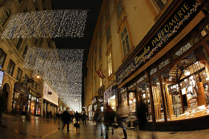 Christmas decorations illuminate a shopping street in the centre of Vienna, Austria.