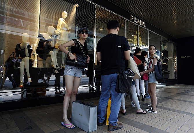 Customers line up outside a Prada store at Hong Kong's shopping district.