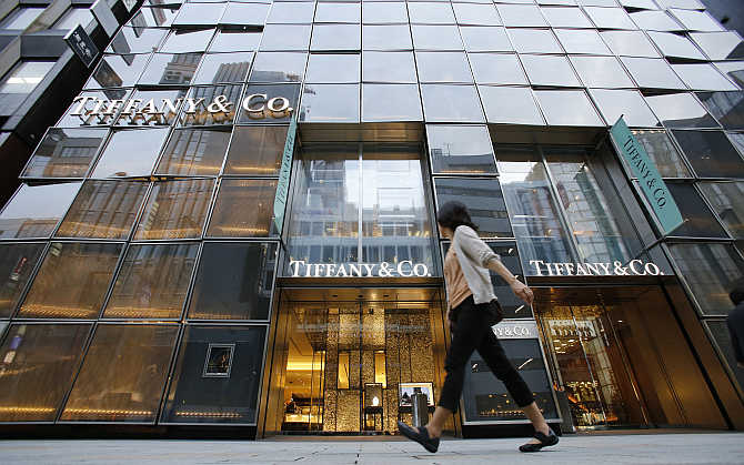 A woman walks past Tiffany Building at Tokyo's Ginza shopping district, Japan.