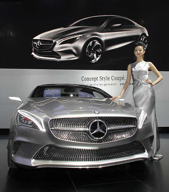 A model stands next to a Mercedes-Benz Concept Style Coupe in Beijing, China.