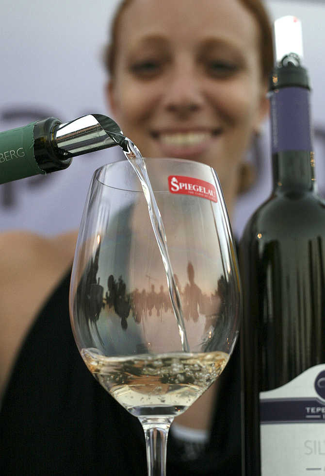 White wine is poured into a glass at the Israeli wine-tasting festival in Jerusalem.