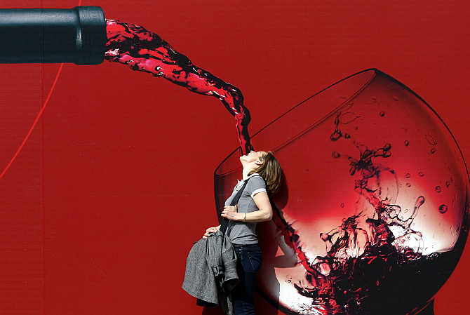 A woman poses for a photo at the Vinitaly wine expo in Verona, Italy.