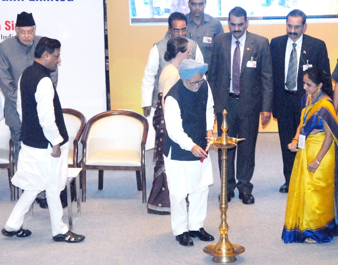 Prime Minister Dr Manmohan Singh lighting the lamp at the inaugural function of the Bharatiya Mahila Bank in Mumbai on Tuesday.