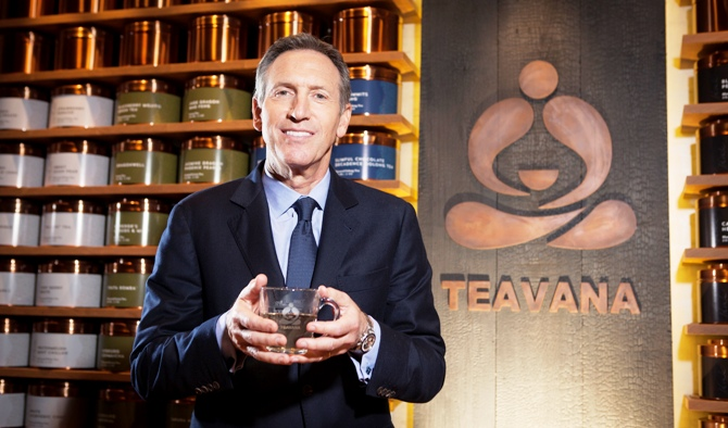 Howard Schultz, chief executive of Starbucks, holds a cup of tea.