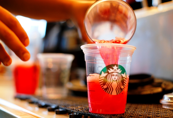 A barista pours a drink at a newly designed Starbucks coffee shop in Fountain Valley, California.