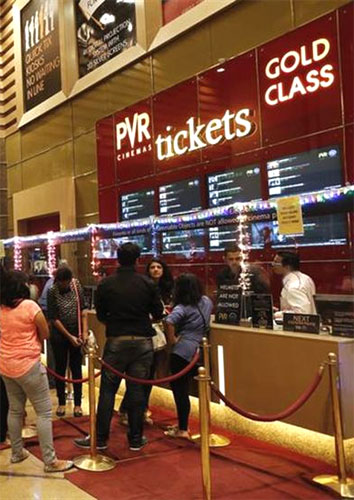 Cinema-goers wait to collect their tickets at a PVR Multiplex in Mumbai.