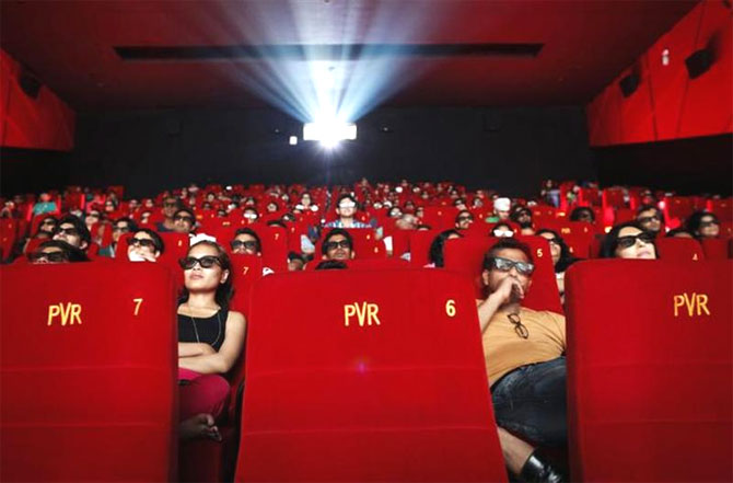 Cinema-goers wearing 3D glasses watch a movie at a PVR Multiplex in Mumbai.