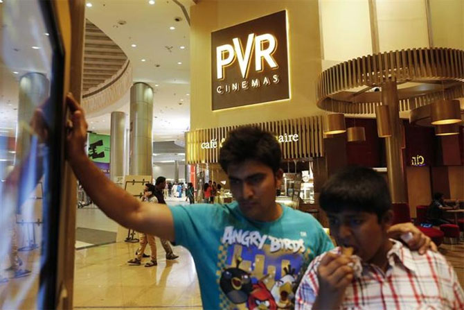 Cinema-goers watch a movie trailer at a PVR Multiplex in Mumbai.