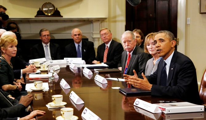 US President Barack Obama meets with health insurance