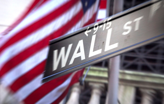 A Wall Street sign is pictured outside the New York Stock Exchange in New York.