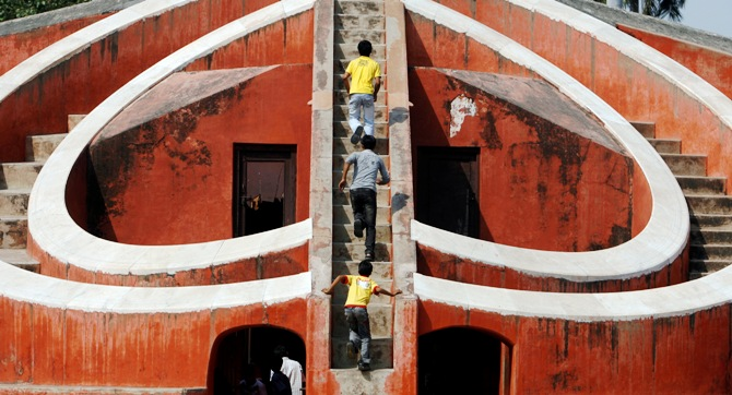 Children play inside one of the instruments of Jantar Mantar, a collection of architectural astronomical instruments, in New Delhi.