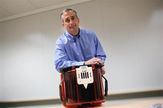 Brian Krzanich poses with a Front Opening Unified Pod at Intel headquarters in Santa Clara, California.