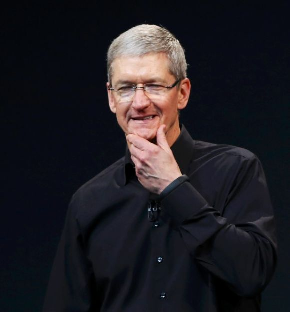 Apple Inc CEO Tim Cook speaks on stage during an Apple event.