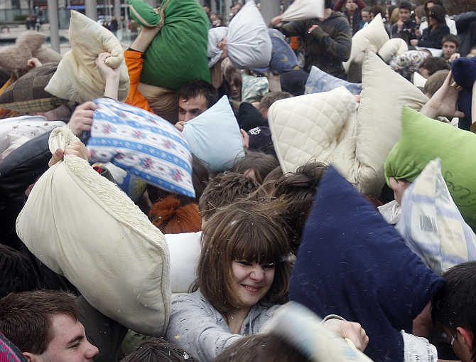 People fight during the International Pillow Fighting Day in Budapest, Hungary.