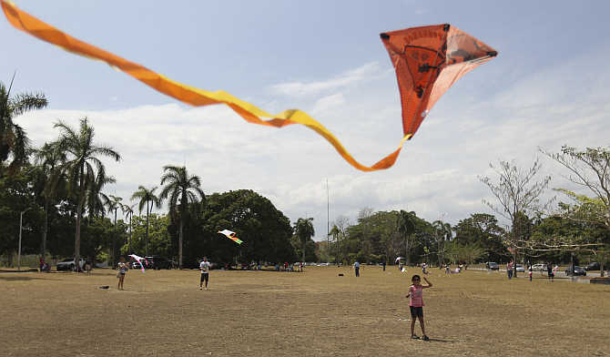 A girl flies her kite in Panama City, Panama.