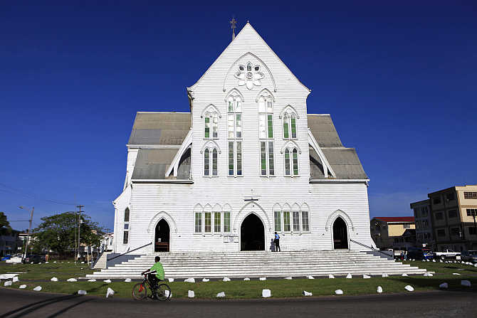 A woman enters St George's Anglican Cathedral in Georgetown, Guyana.