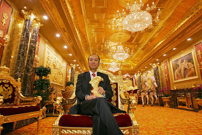 Lam Sai-wing, Chairman, Hang Fung Gold Technology Group, at an exhibition hall decorated with two tonnes of gold next to his jewellery shop in Hong Kong.