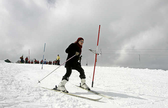 A woman learns to ski in Gulmarg, 55km west of Srinagar.