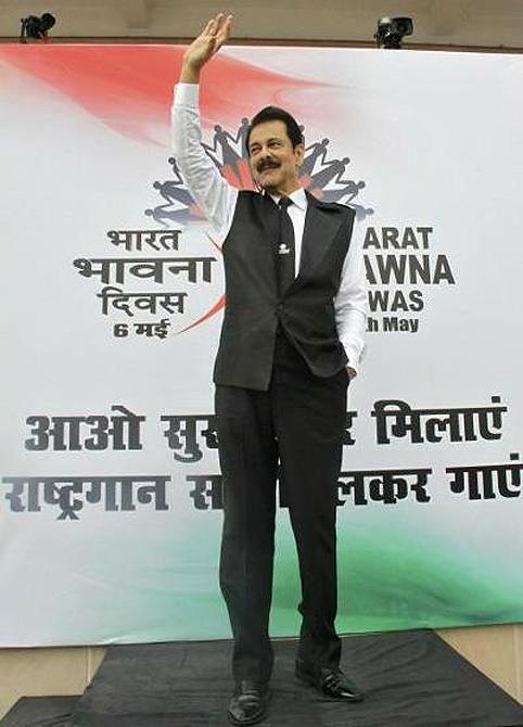 Sahara Group Chairman Subrata Roy waves at his employees.
