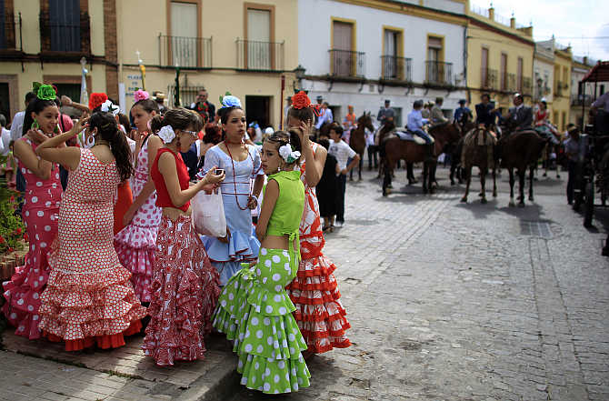 Pilgrims from the Gines brotherhood make their way to the shrine of El Rocio in Gines, near Seville, Spain.