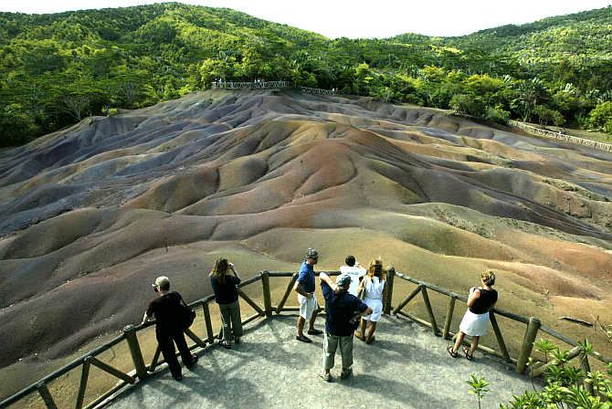 Tourists view the unusual natural phenomena of the seven-coloured earth at Chamarel in west Mauritius.