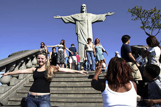 Tourists visit the Christ the Redeemer statue in Rio de Janeiro, Brazil.