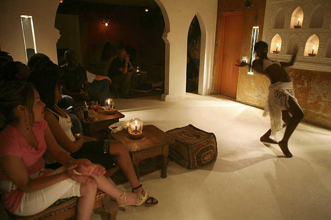 Tourists watch a belly-dancer perform at the Casablanca club in Nairobi, Kenya.
