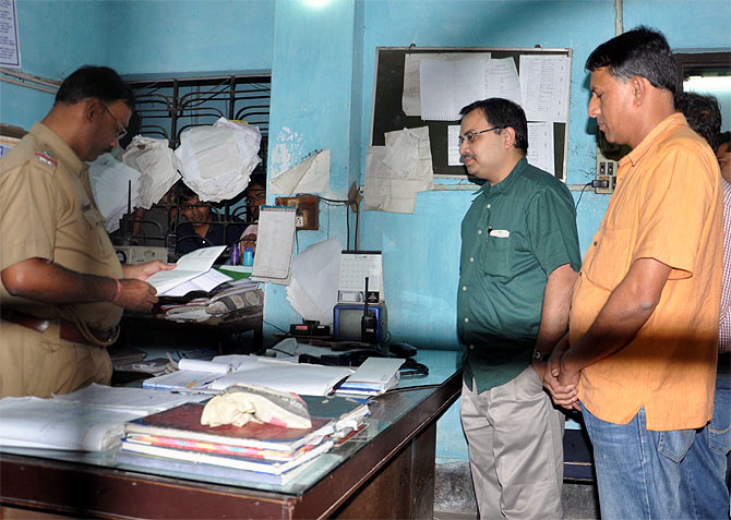 Kunal Ghosh, far left, at the Bidhannagar South police station on Friday, November 22, 2013.