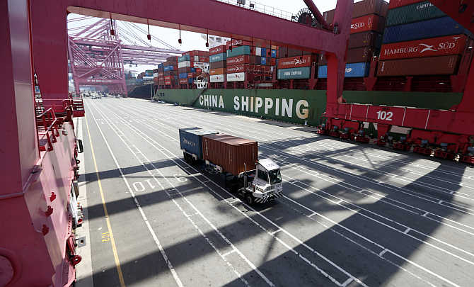 A truck transports containers in Busan, about 420km southeast of Seoul, South Korea.