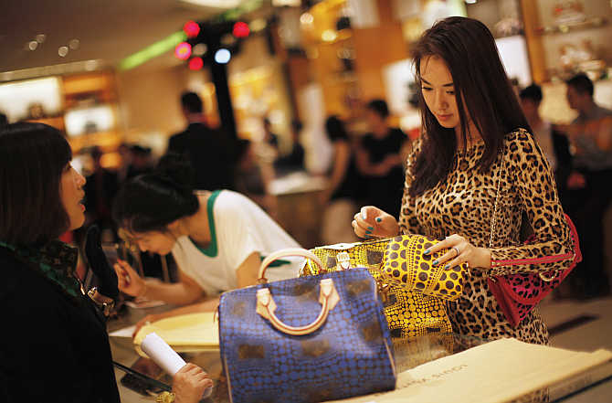 A woman shops in a Louis Vuitton store in Shanghai, China.