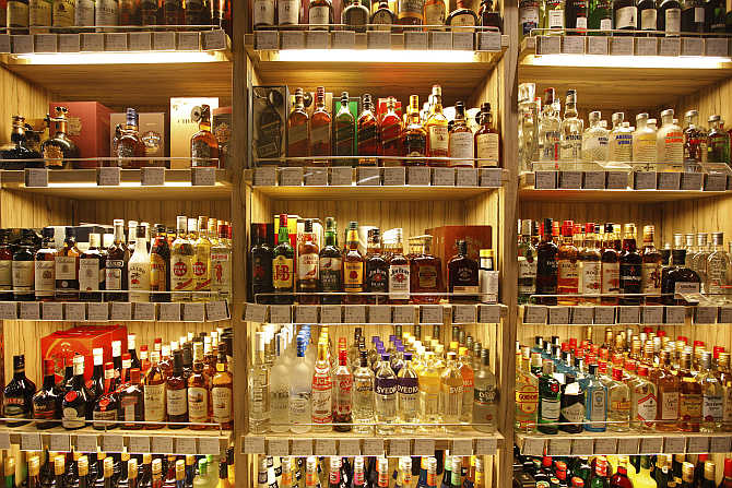 Bottles of whisky are displayed at a supermarket in Shanghai, China.