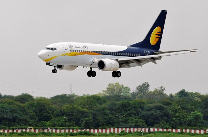 A Jet Airways passenger aircraft prepares to land at the airport.