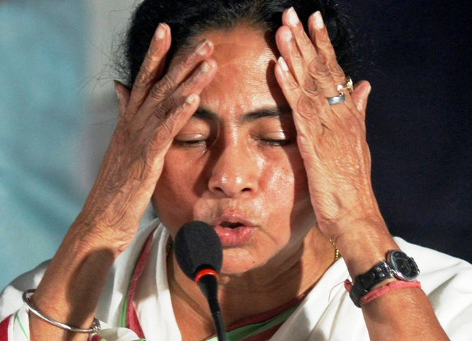 West Bengal Chief Minister Mamata Banerjee gestures during a news conference.