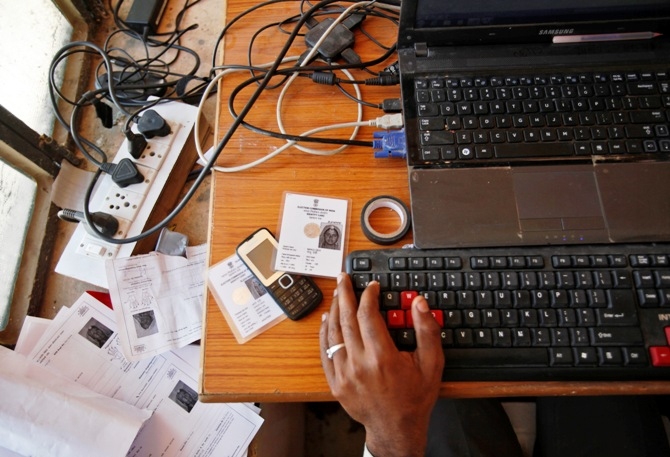 An operator works on his table while enrolling villagers for the Unique Identification (UID) database system at an enrolment centre at Merta district in Rajasthan.