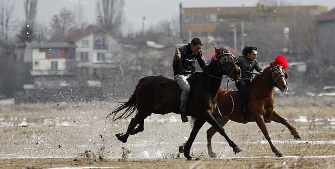 Men ride horses during celebrations marking the traditional holiday Todorov den, also known as the Horse Easter, near Sofia, Bulgaria.