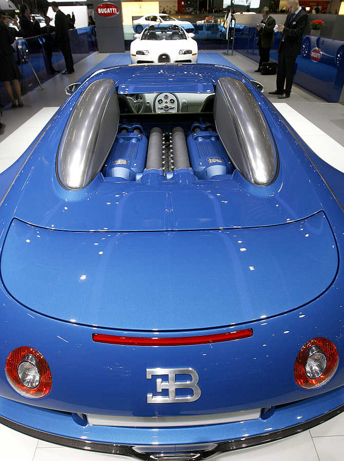 A Bugatti Bleu Centenaire, front, and a Veyron 16.4 on display at the Palexpo in Geneva, Switzerland.