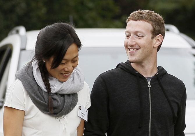 Facebook CEO Mark Zuckerberg walks with his wife Priscilla Chan at the annual Allen and Co. conference at the Sun Valley, Idaho Resort.