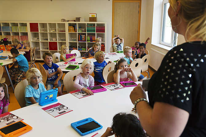 A teacher explains to her students the basics of using their iPads at the Steve Jobs school in Sneek, the Netherlands.