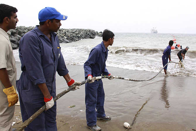 Alcatel-Lucent contractors lay the East African Marine Cable fibre optic cable on the Fujairah shore-end, United Arab Emirates.