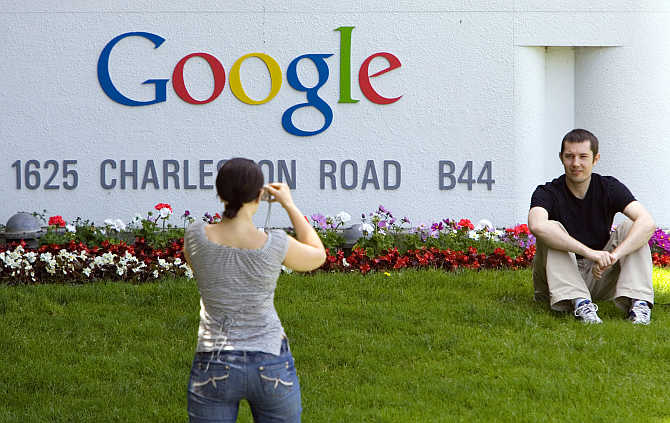 A man has his picture taken in front of Google headquarters in Mountain View, California.