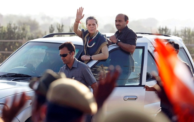 Chief of Congress party Sonia Gandhi (C) waves towards her supporters from a vehicle after she addressed a rally ahead of the state elections in Dungarpur town, Rajasthan.
