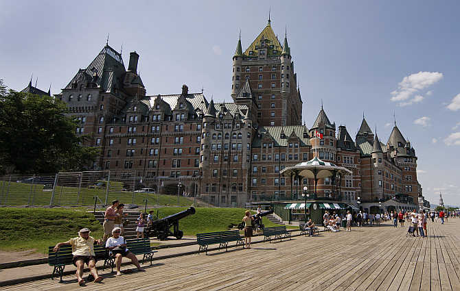 People walk near the Chateau Frontenac in Quebec City, Canada.