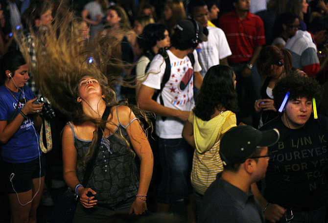 Revellers dance to music on their headphones during a Silent Rave at Union Square Park in New York City, United States.