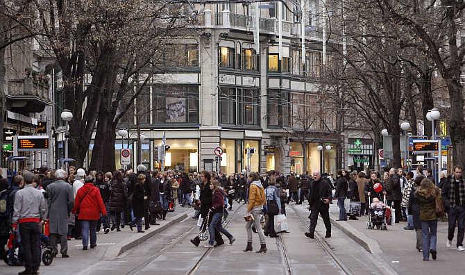 People walk on Zurich's main shopping street Bahnhofstrasse, Switzerland.