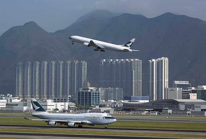 A Cathay Pacific Airways passenger plane takes off at the Hong Kong Airport.