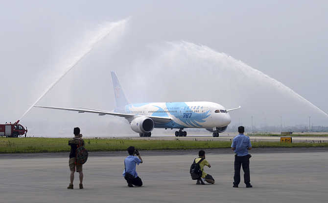 Boeing 787 Dreamliner belonging to China Southern Airlines is given a water cannon salute at Guangzhou airport.