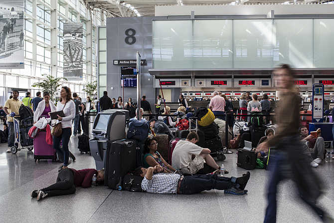 Passengers wait for their flight to London with British Airways at San Francisco International Airport.