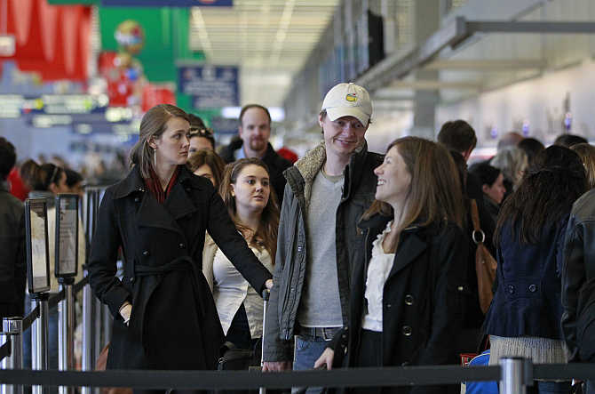 Holiday travellers wait in line for security screening at Chicago's O'Hare International Airport.